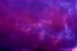dark pink and purple clouds in the sky, polar stratospheric clouds