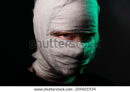 Dark portrait of an infected sick girl with a bandage on her head