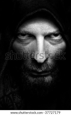 Dark portrait of scary evil sinister bearded man
