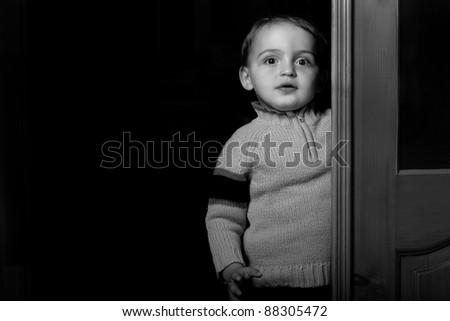 dark portrait of small boy