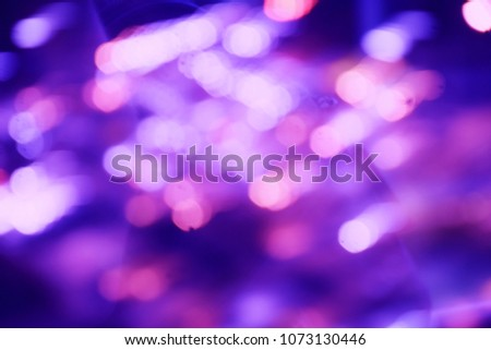 dark purple color abstract bacground withe blurred defocus bokeh light for template #1073130446