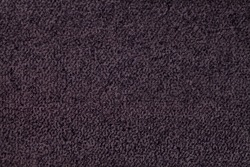 Dark purple fluffy background of soft, fleecy cloth. Texture of violet wool textile backdrop, closeup.