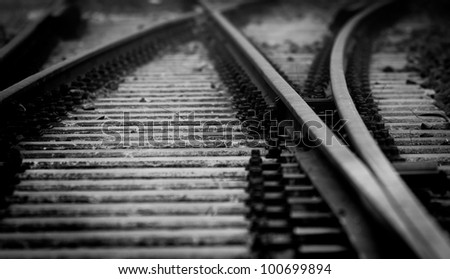 Dark railway closeup with blurry end