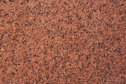 Dark red granite patterned texture or background. natural marble