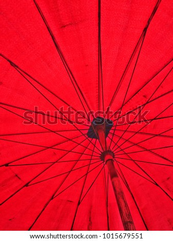 Dark red umbrella with solid wire frame. #1015679551
