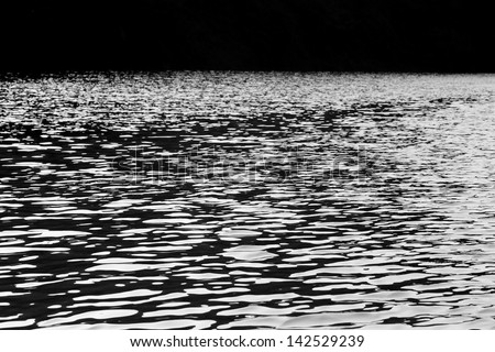 dark river water reflections in black and white