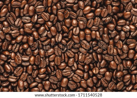 Dark roast coffee beans background, top view