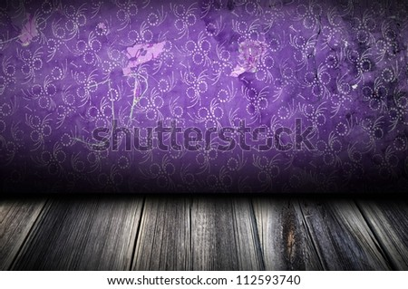 Dark room with purple wall with pattern on it useful as texture or background
