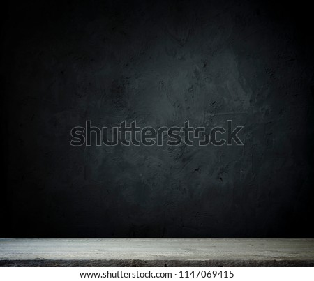 Dark room with tile floor and brick wall background #1147069415