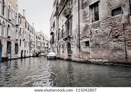 dark scene of Venice buildings and water, Italy