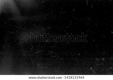 Photo of  Dark scratched grunge background, old film effect, space for your text or picture, dusty texture