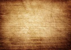 Dark scratched grunge cutting board. Wooden texture.