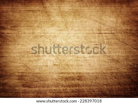 Dark scratched grunge cutting board. Wooden texture. Сток-фото ©