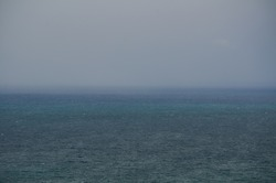 Dark sea with dark blue horizon sky day background.