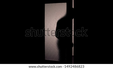 Dark shadow of hooded man opening glass door, danger of burglary dark background #1492486823
