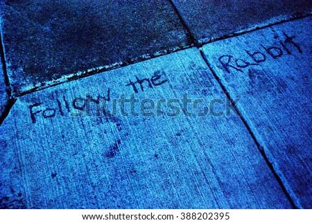 Dark sidewalk inscription,