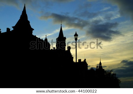 Dark silhouette of old buildings against evening sky in Karlovy Vary, Czech Republic
