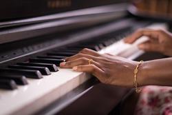 Dark Skin Female Hands Playing Piano
