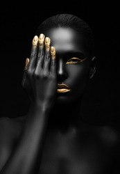 dark-skinned woman covering one eye.