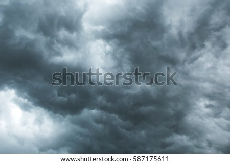 Dark sky and black clouds before rainy, Dramatic black cloud and thunderstorm #587175611