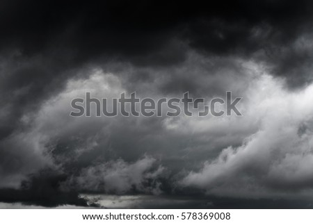Dark sky and black clouds before rainy, Dramatic black cloud and thunderstorm high contrast #578369008