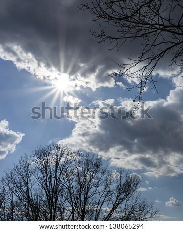 dark sky with sun light coming through the cloud  and sun beam