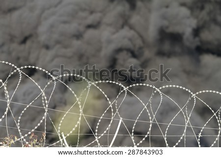 Dark smoke of the fire at the oil depot and the wire