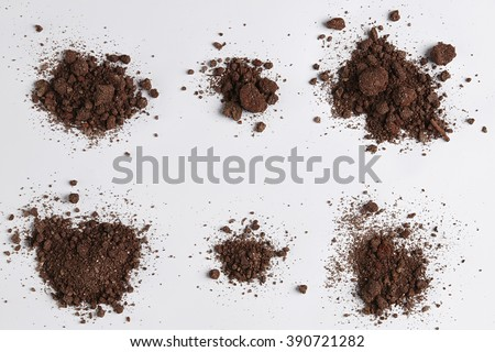 Dark Soil isolated on White Background. Pile of Dirt and Stones. Top View of a Heap of Ground. Close Up Macro View Collection