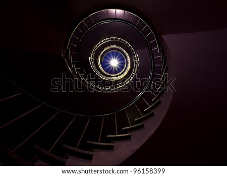 Dark Spiral staircase moving towards the light