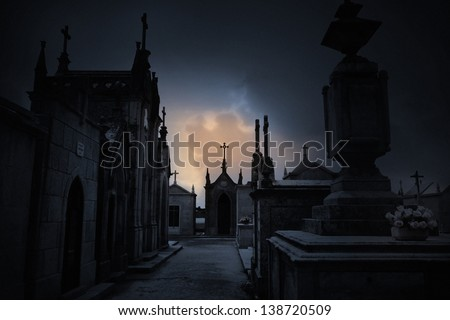 Dark spooky Halloween european graveyard with clouds