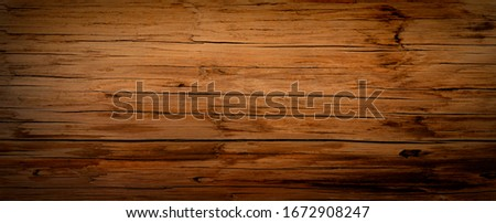 Dark stained reclaimed wood surface with aged boards lined up. Wooden floor planks with grain and texture. Stock photo ©