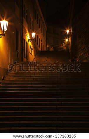 dark staircase enlightened with lanterns