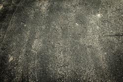 Dark stone asphalt with grimey rustic filth.