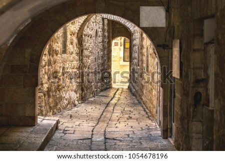 dark stone lanes of the ancient city