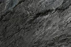 Dark stone or rock texture background. High resolution wall design texture