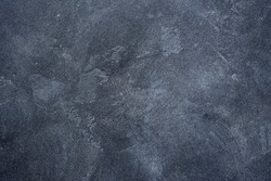 Dark stone or slate wall.Grunge background.
