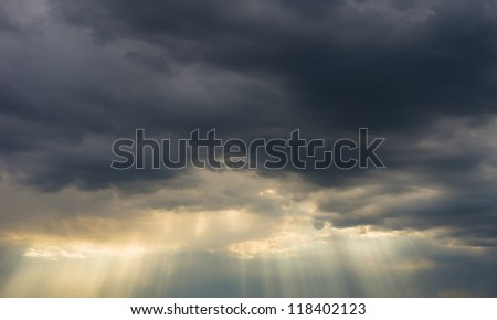 dark storm clouds and sun rays