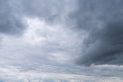Dark storm clouds in the sky. Overcast sky before the rain. Dark gray dust clouds