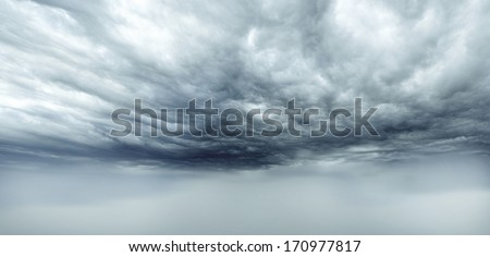 Dark storm clouds sky. Copy space below
