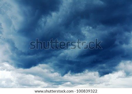 Dark storm clouds stretching towards the horizon