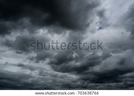 dark storm clouds with background,Dark clouds before a thunder-storm. #703638766