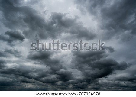 dark storm clouds with background,Dark clouds before a thunder-storm.