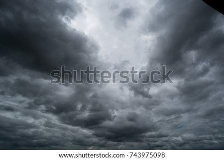 dark storm clouds with background,Dark clouds before a thunder-storm. #743975098