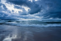 Dark storm sky above the Baltic sea, waves and water splashes. Dramatic cloudscape. Nature, environment, fickle weather, climate change. Atmospheric scenery. Panoramic view, long exposure, canada.
