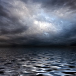 dark storm sky over water surface with artistic shadows added