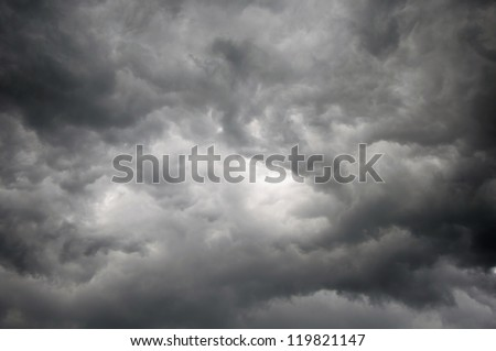 Dark storm sky with light patch in the center