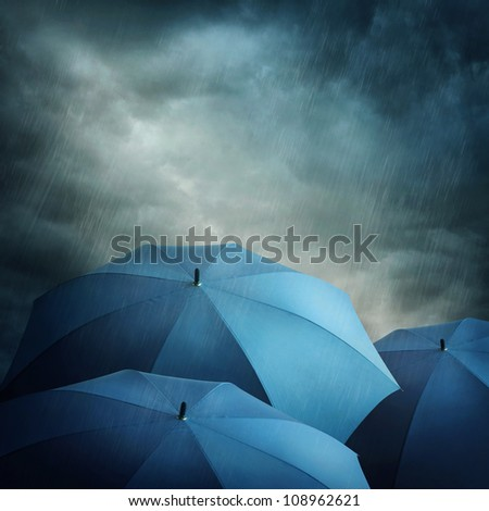 Dark stormy clouds and umbrellas