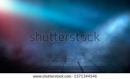 Dark street, night smog and smoke neon light. Dark background of the night city, ray of light in the dark. Gloomy dark background. #1371344546