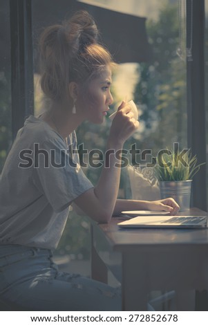 Dark style beauty some only position of the light down adult woman sipping coffee looking through window and thinking for plan something vintage morning she as always thinking sitting at cafe coffee