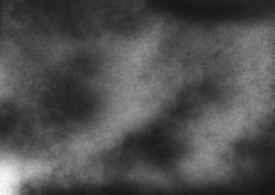Dark subtle grit texture. Gritty grunge background with black paint splatter on paper